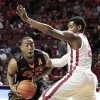 Cowboy\'s Markel Brown (22) looks to pass around Sooner\'s Steven Pledger (2) as the University of Oklahoma Sooners (OU) play the Oklahoma State Cowboys (OSU) in NCAA, men\'s college basketball at The Lloyd Noble Center on Saturday, Jan. 12, 2013 in Norman, Okla. Photo by Steve Sisney, The Oklahoman
