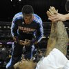 Oklahoma City Thunder guard Nate Robinson talks with Denver Nuggets forward Wilson Chandler during warm ups before the start of game 3 of a first-round NBA basketball playoff series Saturday, April 23, 2011, in Denver. (AP Photo/Jack Dempsey)