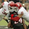 OU\'s R.J. Washington (11) collides with Javon Harris (30) as he brings down Texas Tech\'s Erich Stephens Jr. (24) during a college football game between the University of Oklahoma (OU) and Texas Tech University at Jones AT&T Stadium in Lubbock, Texas, Saturday, Oct. 6, 2012. Photo by Nate Billings, The Oklahoman