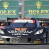 Photo - Ricky Taylor dives the Corvette DP out of the horseshoe turn during the IMSA Series Rolex 24 hour auto race at Daytona International Speedway in Daytona Beach, Fla., Saturday, Jan. 25, 2014. (AP Photo/John Raoux)
