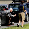 Jerry Sandusky gets out of his Attorney Karl Rominger\'s car, Sunday, June 17, 2012, in Lemont, Pa. After four days of testimony that saw eight men from 18 to 28 years old tell jurors that Sandusky sexually abused them as children, the former Penn State assistant football coach could take the stand in his own defense at his criminal trial, but it\'s not certain that will happen as trial resumes on Monday. (AP Photo/Centre Daily Times, Abby Drey)