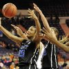 Duke\'s Richa Jackson, left, reaches for a loose ball during the second half of an NCAA college basketball game against Clemson, Thursday, Jan. 24, 2013, at Littlejohn Coliseum in Clemson, S.C. Duke won 60-46. (AP Photo/Richard Shiro)