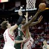 Photo - Milwaukee Bucks center Larry Sanders (8) drives to basket between Houston Rockets center Omer Asik (3) and forward Donatas Motiejunas (20) during the first half of an NBA basketball game, Wednesday, Feb. 27, 2013 in Houston. (AP Photo/Bob Levey)