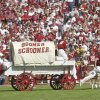 The Ruf Neks take the Sooner Schooner for a trip across Owen Field following an OU touchdown during their college football game with KSU on Sept. 29, 2001. Staff photo by Jim Beckel.