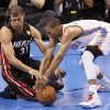 Miami\'s Shane Battier (31) and Oklahoma City\'s Russell Westbrook (0) go for a loose ball during Game 2 of the NBA Finals between the Oklahoma City Thunder and the Miami Heat at Chesapeake Energy Arena in Oklahoma City, Thursday, June 14, 2012. Photo by Nate Billings, The Oklahoman