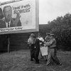 FILE - In this Sept. 4, 1963 file photo, police wrestle with an unidentified white man near a billboard after a demonstration at the newly-integrated Graymont Elementary School in Birmingham, Ala. 1963 was a year of revolution in race relations in the United States. (AP Photo/File)