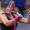 Australian Samantha Stosur hits a forehand against Russia\'s Maria Sharapova during their quarterfinal match at the Porsche tennis Grand Prix in Stuttgart, Germany, Friday, April 27, 2012. (AP Photo/Michael Probst) ORG XMIT: PSTU121