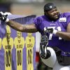 Minnesota Vikings tackle, and former Oklahoma standout, Phil Loadholt stretches during NFL football training camp, Monday, July 29, 2013, in Mankato, Minn. (AP Photo/Charlie Neibergall)
