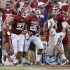 Oklahoma\'s Trey Millard (33) celebrates with David Smith (25), and Trevor Knight (9) after scoring a touchdown during a college football game between the University of Oklahoma Sooners (OU) and the West Virginia University Mountaineers at Gaylord Family-Oklahoma Memorial Stadium in Norman, Okla., on Saturday, Sept. 7, 2013. Oklahoma won 16-7. Photo by Bryan Terry, The Oklahoman