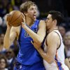 Oklahoma City\'s Nick Collison (4) defends Dallas\' Dirk Nowitzki (41) during an NBA basketball game between the Oklahoma City Thunder and the Dallas Mavericks at Chesapeake Energy Arena in Oklahoma City, Monday, Feb. 4, 2013. Photo by Nate Billings, The Oklahoman