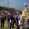 Kody Turner\'s mom, Crystal Coleman, show the crowd the game ball before Chickasha\'s home game against Capitol Hill on Friday. PHOTO BY SARAH PHIPPS, THE OKLAHOMAN
