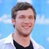 "In a May 23, 2012 file photo Phillip Phillips arrives at the American Idol Finale on in Los Angeles. Phillips says he wasn\'t that excited about performing the song ""Home"" when he won ""American Idol"" this year. But now, the 21-year-old says he\'s ""starting to grow a connection"" to the song, thanks to its use in the 2012 Olympics. ""Home"" has been used in commercials for the ""Fab 5,"" the five American female gymnasts who scored gold in the all-around team competition last week. As a result, the song\'s digitals sales have jumped, selling 228,000 in the last week, a 472 percent increase, according to Nielsen Soundscan. ""Home"" also leaped 80 spots to No. 9 on the Billboard Hot 100 chart this week. It\'s sold 844,215 tracks since its June release. (AP Photo by Jordan Strauss/Invision/AP)"