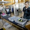 Cody Coale gathers his belongings after going through a security checkpoint at Will Rogers World Airport in Oklahoma City, Friday, August 12, 2011. Photo by Bryan Terry, The Oklahoman