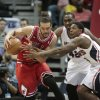 Photo - Chicago Bulls center Joakim Noah, left, and Atlanta Hawks guard Lou Williams, right front, scramble for a loose ball as Hawks' Elton Brand watches during the first half of an NBA basketball game Wednesday, April 2, 2014, in Atlanta. (AP Photo/Jason Getz)