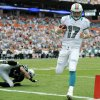 Photo -   Miami Dolphins quarterback Ryan Tannehill (17) scores a touchdown during the first half of an NFL football game against the Oakland Raiders, Sunday, Sept. 16, 2012, in Miami. (AP Photo/Rhona Wise)