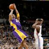 Photo - L.A. LAKERS: Kobe Bryant of the Lakers shoots the ball as Kyle Weaver of Oklahoma City watches during the NBA basketball game between the Los Angeles Lakers and the Oklahoma City Thunder at the Ford Center, Tuesday, Feb. 24, 2009. The Thunder lost 107-93. PHOTO BY BRYAN TERRY, THE OKLAHOMAN ORG XMIT: KOD