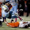 Putnam City West\'s Steven Stallings is tripped up by Norman\'s Gavin Nadeau during the high school football game between Putnam City West and Norman at Putnam City High School, Thursday, Oct. 25, 2012. Photo by Sarah Phipps, The Oklahoman