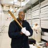Photo - Former Chicago White Sox player Frank Thomas holds a Babe Ruth bat in the archives area during his orientation visit at the Baseball Hall of Fame on Monday, March 3, 2014, in Cooperstown, N.Y. Thomas will be inducted to the hall in July. (AP Photo/Mike Groll)