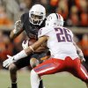Oklahoma State\'s Michael Harrison tries to get past Arizona\'s Jourdon Grandon during the fourth quarter of the Cowboys\' win on Thursday in Stillwater. PHOTO BY NATE BILLINGS, The Oklahoman