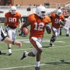 OSU\'s Johnny Thomas (12) returns an interception in front of Cooper Bassett (80), Anthony Rogers (94) and Jeremy Smith (31) during the Orange/White spring football game for the Oklahoma State University Cowboys at Boone Pickens Stadium in Stillwater, Okla., Saturday, April 16, 2011. Photo by Nate Billings, The Oklahoman