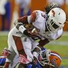 Photo - Arkansas running back Alex Collins (3) is tackled by Florida defensive back Jabari Gorman after a short gain during the first half of an NCAA college football game in Gainesville, Fla., Saturday, Oct. 5, 2013. (AP Photo/John Raoux)