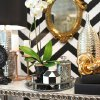 Photo -  Mixing Metals: Adding accents in silver, gold and copper, in finishes ranging from polished to patina, is a great way to add a glamorous edge to your home — and put the recession in the rearview mirror. PHOTO PROVIDED BY NIKKI CHU HOME