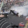 Kyle Larson\'s car (32) gets airborne during a multi-car wreck on the final lap of the NASCAR Nationwide Series auto race Saturday, Feb. 23, 2013, at Daytona International Speedway in Daytona Beach, Fla. Tony Stewart, in the red car at front, won the race. (AP Photo/David Graham)