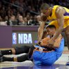 Oklahoma City Thunder guard Thabo Sefolosha, left, of Switzerland, battles Los Angeles Lakers forward Metta World Peace for the loose ball during the first half of their NBA basketball game, Friday, Jan. 11, 2013, in Los Angeles. (AP Photo/Mark J. Terrill)