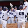 Photo - TCU's Kyle Bacak, left, and Kevin Cron, right, celebrate after scoring runs in the sixth inning of the championship game against Oklahoma State in the Big 12 conference NCAA college baseball tournament in Oklahoma City, Sunday, May 25, 2014. (AP Photo/Alonzo Adams)