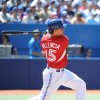 Photo - Toronto Blue Jays' Danny Valencia hits a single against the Detroit Tigers  during the fourth  inning of a baseball game on Sunday, Aug. 10, 2014, in Toronto. (AP Photo/The Canadian Press, Jon Blacker)