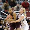 Eastern Kentucky\'s Jasmine Stafford, left, attempts to keep the ball away from Louisville\'s Shelby Harper during the second half of their NCAA college basketball game, Wednesday, Nov. 28, 2012, in Louisville, Ky. Louisville won 76-42. (AP Photo/Timothy D. Easley)