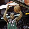 Milwaukee Bucks forward John Henson (31) dunks against the Houston Rockets during the first half of an NBA basketball game, Wednesday, Feb. 27, 2013 in Houston. (AP Photo/Bob Levey)