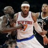 Photo - New York Knicks' Carmelo Anthony, center, fights with Brooklyn Nets' Kevin Garnett, left, and Paul Pierce for a rebound during the first half of the NBA basketball game at Madison Square Garden Monday, Jan. 20, 2014, in New York. (AP Photo/Seth Wenig)