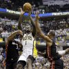Indiana Pacers\' Lance Stephenson, center, puts up a shot between Miami Heat\'s Dwyane Wade (3) and Chris Bosh during the second half of Game 3 of the NBA Eastern Conference basketball finals in Indianapolis, Sunday, May 26, 2013. (AP Photo/Nam H. Huh)