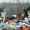 Donna Sebastian, left, and Ron Vines, a neighbor, search through the rubble of her home on Carlisle Road looking for two six-week old puppies. Friday, March 2, 2012 in Boone County, Ky. Powerful storms stretching from the Gulf Coast to the Great Lakes flattened buildings in several states, wrecked two Indiana towns and bred anxiety across a wide swath of the country in the second powerful tornado outbreak this week. (AP Photo/The Cincinnati Enquirer, Patrick Reddy) MANDATORY CREDIT; NO SALES ORG XMIT: OHCIN108