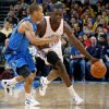Oklahoma City\'s\' Reggie Jackson (15) drives past Dallas\' Jerome Randle (9) during a preseason NBA game between the Oklahoma City Thunder and the Dallas Mavericks at Chesapeake Energy Arena in Oklahoma City, Tuesday, Dec. 20, 2011. Photo by Bryan Terry, The Oklahoman