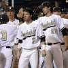 Photo - Vanderbilt's Vince Conde (3) is congratulated after scoring against Xavier on a double by Xavier Turner during the fourth inning of an NCAA college baseball tournament regional game Friday, May 30, 2014, in Nashville, Tenn. (AP Photo/Mark Humphrey)