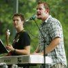 Ryan Hartquist, right, sings as he plays the keyboards while Zac Speegle plays the bass during the Elizabeth Speegle Band\'s performance at Hafer Park as part of the Concert in the Park Series in Edmond, Okla., Thursday, July 10, 2008. BY NATE BILLINGS, THE OKLAHOMAN