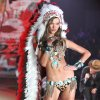This Nov. 7, 2012 photo released by Starpix shows model Karlie Kloss wearing an Indian headdress during the taping of The 2012 Victoria\'s Secret Fashion Show in New York. Victoria Secret has apologized for putting a replica of a Native American headdress on a model for its annual fashion show. The company responded to criticism over the weekend by saying it was sorry to have upset anyone and would not include the outfit in the show's television broadcast next month. (AP Photo/Starpix, Amanda Schwab)
