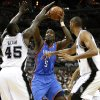 Oklahoma City\'s Kendrick Perkins (5) shoots the ball between San Antonio\'s DeJuan Blair (45) and Tim Duncan (21) during Game 5 of the Western Conference Finals between the Oklahoma City Thunder and the San Antonio Spurs in the NBA basketball playoffs at the AT&T Center in San Antonio, Monday, June 4, 2012. Photo by Nate Billings, The Oklahoman