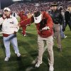 Photo -  Oklahoma coach Bob Stoops bowed to the fans after the Sooners' 65-13 rout of Texas Tech in 2008. PHOTO BY NATE BILLINGS, THE OKLAHOMAN ARCHIVE
