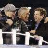 Photo - Seattle Seahawks head coach Pete Carroll, center, celebrates with Seattle Seahawks owner Paul Allen, left, and general manager John Schneider, right, after the NFL Super Bowl XLVIII football game against the Denver Broncos Sunday, Feb. 2, 2014, in East Rutherford, N.J. The Seahawks won 43-8. (AP Photo/Ted S. Warren)
