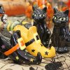 Photo - Salt and pepper shakers shaped like black cats and witches shoes are a cute way to dress up your Halloween dinner table. Sold at Scruples of Edmond. Photo by David McDaniel, The Oklahoman