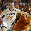 Oklahoma State\'s Phil Forte (13) goes past Texas\' Damarcus Croaker (5) during an NCAA college basketball game between the Oklahoma State Cowboys (OSU) and the University of Texas Longhorns at Gallagher-Iba Arena in Stillwater, Okla., Wednesday, Jan. 8, 2014. Oklahoma State won 87-74. Photo by Bryan Terry, The Oklahoman