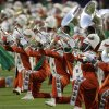 The Florida A&M University band performs on the field before the NFL Super Bowl XLIV football game between the Indianapolis Colts and New Orleans Saints in Miami, Sunday, Feb. 7, 2010. (AP Photo/Rob Carr) ORG XMIT: SB183