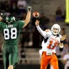 OSU quarterback Zac Robinson (11) throws under pressure from Baylor\'s Jason Lamb (88) in the second half during the college football game between Oklahoma State University and Baylor University at Floyd Casey Stadium in Waco, Texas, Saturday, Nov. 17, 2007. BY MATT STRASEN, THE OKLAHOMAN
