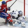Toronto Maple Leafs goaltender James Reimer makes a save against Montreal Canadiens\' Brendan Gallagher, left, during the third period of an NHL hockey game in Montreal, Saturday, Feb. 9, 2013. (AP Photo/The Canadian Press, Graham Hughes)