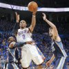 Oklahoma City\'s Russell Westbrook (0) puts up a shot over Memphis\' Mike Conley (11) and Marc Gasol (33) during game one of the Western Conference semifinals between the Memphis Grizzlies and the Oklahoma City Thunder in the NBA basketball playoffs at Oklahoma City Arena in Oklahoma City, Sunday, May 1, 2011. Photo by Chris Landsberger, The Oklahoman ORG XMIT: KOD