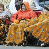 Melissa (left), Terry, and Jessica Kennedy bundle up to watch the Oklahoma State Cowboy\'s homecoming parade in downtown Stillwater, OK, Saturday, Oct. 29, 2011. By Paul Hellstern, The Oklahoman