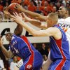From left, Sherron Collins (4) and Cole Aldrich (45) of KU along with OSU\'s Matt Pilgrim (31) attempt to rebound the ball in the first half during the men\'s college basketball game between the University of Kansas (KU) and Oklahoma State University (OSU) at Gallagher-Iba Arena in Stillwater, Okla., Saturday, Feb. 27, 2010. Photo by Nate Billings, The Oklahoman